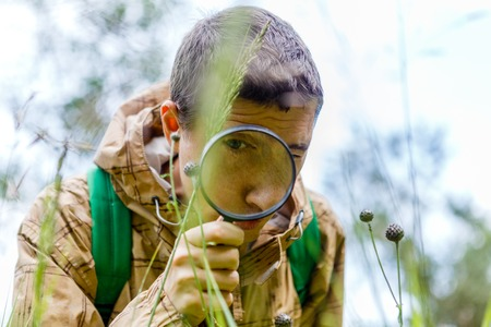Picture of environmentalist man with magnifying glass Stock Photo
