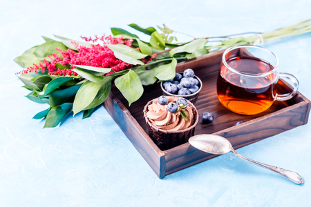 Image of cake, blueberry, red flowers Stock Photo