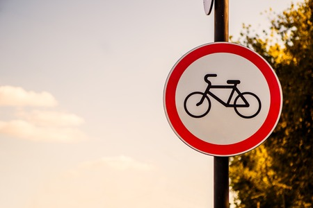 Photo of red road bike sign