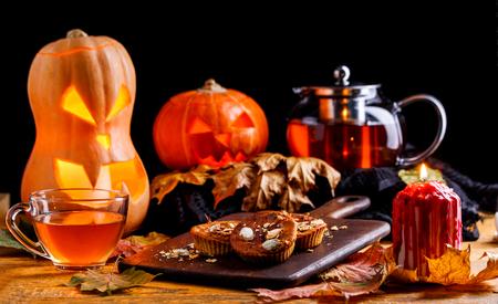Photo of halloween pumpkins, cakes, cup of tea Stock Photo