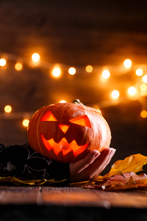 Picture of halloween background with pumpkin and witch hand