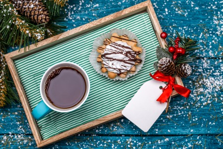 Christmas image of tray with tea and cakes
