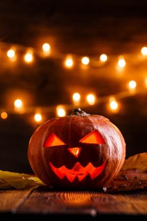 Photo of halloween pumpkin cut in shape of face Stock Photo