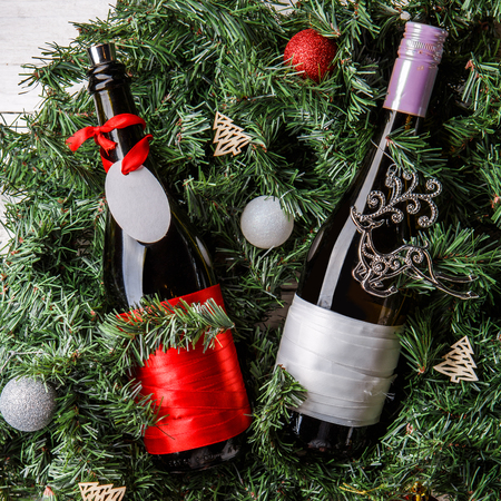 Photo of spruce branches with two bottles of wine, blank greeting card Stock Photo