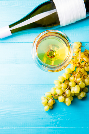 Image from above of glass with juice, grapes, bottle Stock Photo