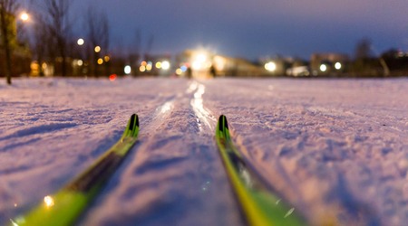 Photo of skis on background of burning lights