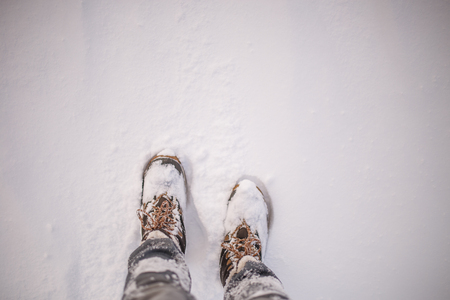 Image of mans feets in boots in snow
