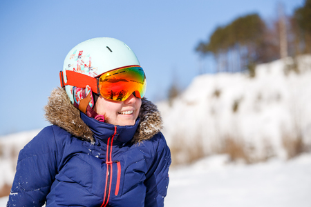 Image of female athlete in mask and helmet