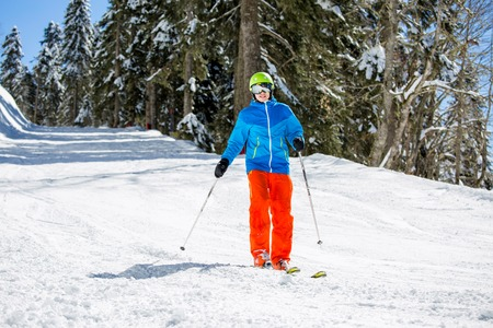 Image of sports man skiing on snowy slope
