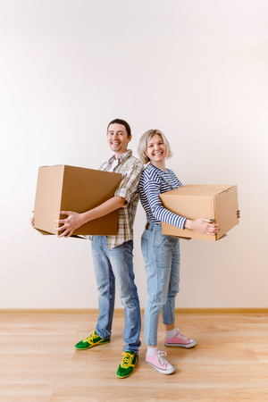 Image of young man and woman with cardboard box