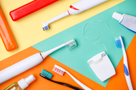 Image of toothbrushes, tubes of pastes, floss