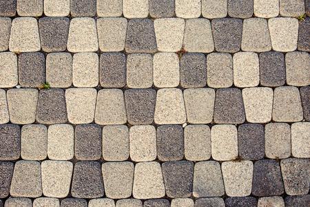 Fragment of stone pavement cobble-stones texture as a background Фото со стока
