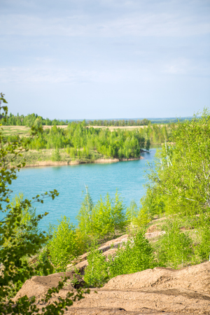 Photo of picturesque hilly terrain and blue lake Stock Photo