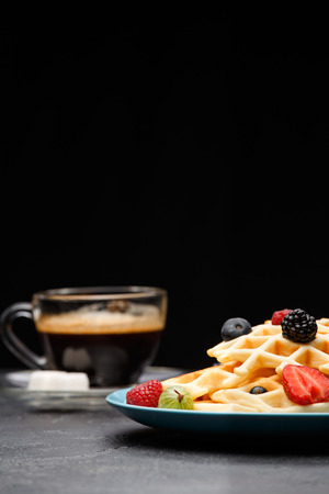 Photo of cup of coffee with sugar with Belgian waffles with strawberries, raspberries Reklamní fotografie