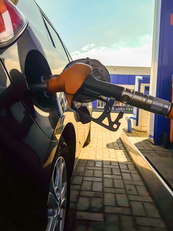 Photo of refueling black car summer