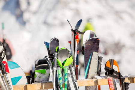 Image of multi-colored skis in snow at winter resort
