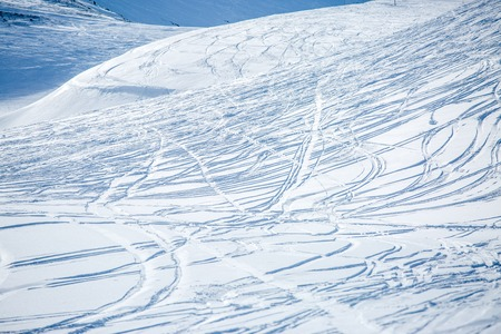 Snow surface with ski in winter