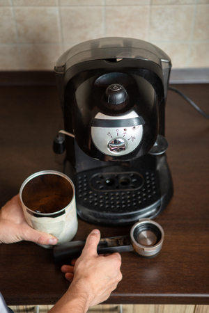 Coffee maker, mans hands holding coffee mug Stock Photo