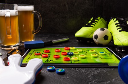 Image of two mugs of foam beer, table football, ball, rattle toy Standard-Bild - 118056434