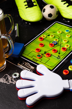 Photo of table football, soccer ball, boots, toys Standard-Bild - 118056437