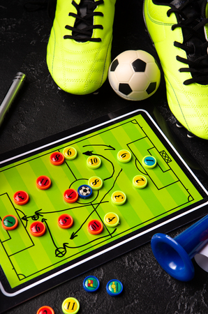 Photo of table football, soccer ball, boots, toys Standard-Bild - 118056441