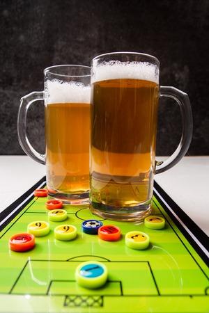 Image of two mugs of beer, table football Standard-Bild - 118056634