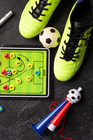 Photo of table football, soccer ball, boots, pipes Standard-Bild - 118056639