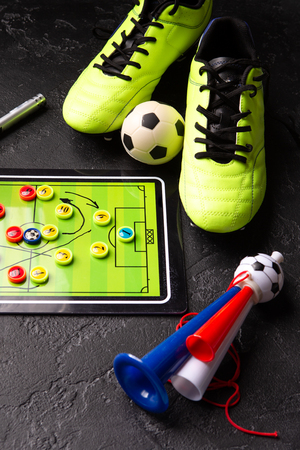 Photo of table football, soccer ball, boots, pipes Standard-Bild - 118056642