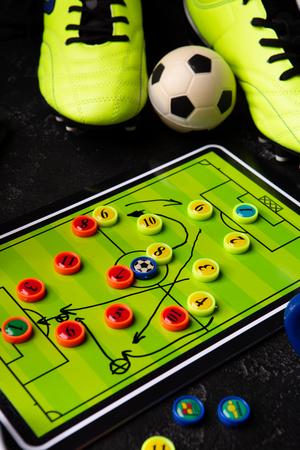 Photo of table football, soccer ball, boots, toys Standard-Bild - 118056767