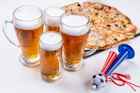 Image of glasses with foam beer, pizza, pipes
