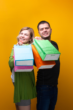 Image of man and woman with shopping bags
