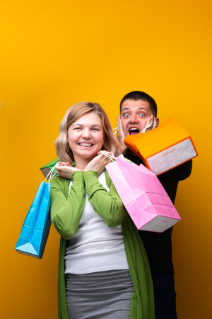 Screaming man and woman with shopping bags