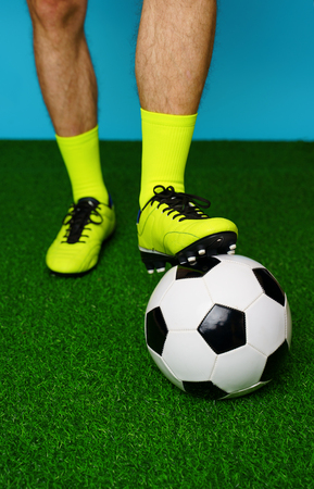 Soccer player with ball on the green grass.