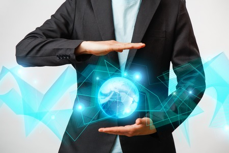 Businessman holding the glowing hologram digital globe. Concepr of business and innovation