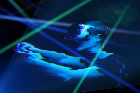 Man with virtual reality headset is playing game. Image with glitch effect. 版權商用圖片