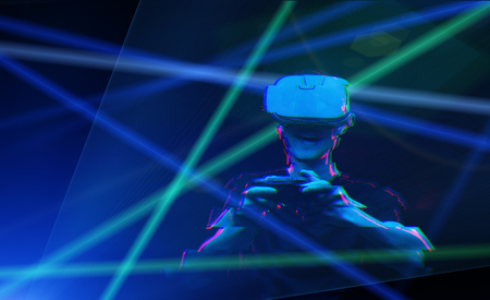 Man with virtual reality headset is playing game. Image with glitch effect. Imagens