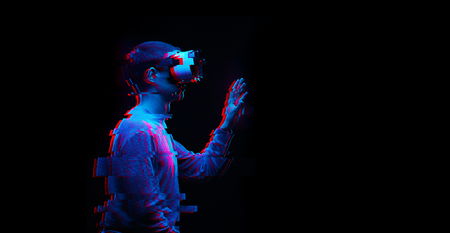 Man is using virtual reality headset. Image with glitch effect. 版權商用圖片