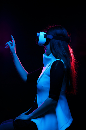 Woman is using virtual reality headset.