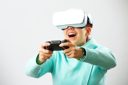 Woman with virtual reality headset is playing game.
