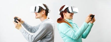 Man and woman with virtual reality headset are playing game.