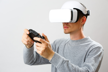 Man with virtual reality headset is playing game.