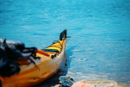 Orange kayak on blue sea in Norway on summer Foto de archivo