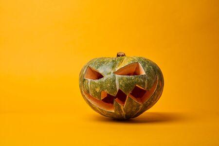 Picture of halloween pumpkin on empty orange background