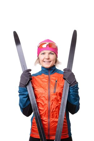 Image of smiling sportswoman with skis on empty white background. 版權商用圖片
