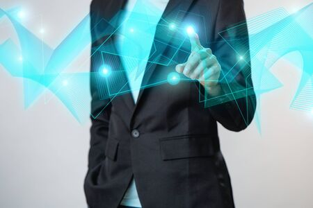 Businessman interacts with a digital network.