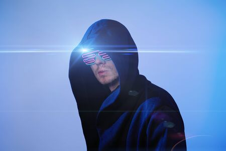 Man in hood and cyber glasses.