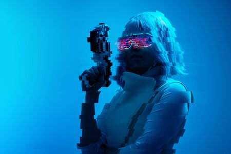Girl with blaster in the futuristic battle. Concept virtual reality, cyber game. Image with glitch effect.