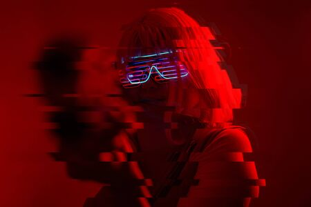 Girl with blaster in the futuristic battle. Concept virtual reality, cyber game and science fiction. Image with glitch effect.