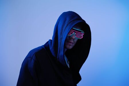 Man in hood and cyber glasses. Game character.