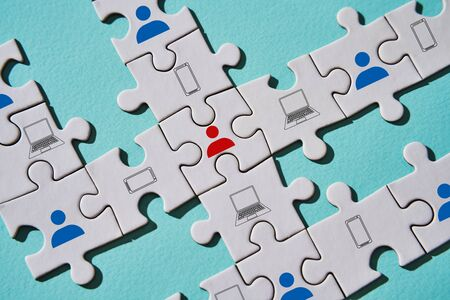 Puzzle pieces as example of stopping the spread of virus with help online communication.